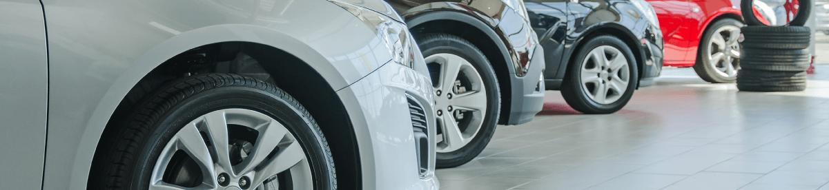 Customers at a used car dealership